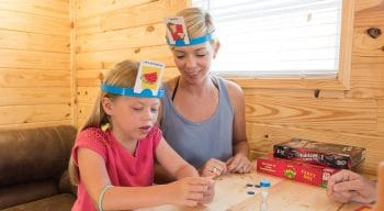 Two girls playing board games in their cottage