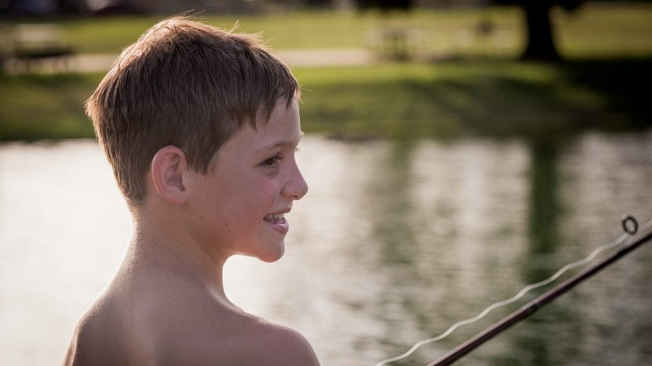 Boy fishing in the pond