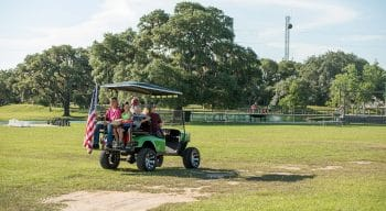 Family riding on a golf kart