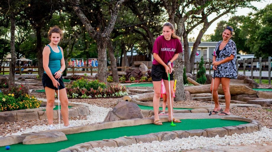Teens playing putt putt